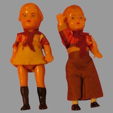 Celluloid Cowboy and Girl Dolls - b283