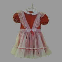White Pinafore Over Red Winnie the Pooh Dress