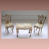 Beautiful all silver miniature Table and two chairs with cherubs on.