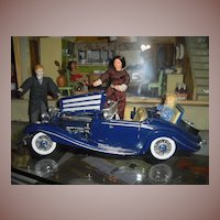 "Beautiful vintag Mercedes with ""family"" of 3 Cacao dolls."