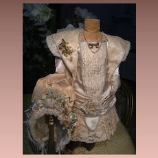 Extremely beautiful French haute couture costume and gorgeous French hat.