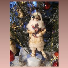 Antique Christmas decoration little boy with his horse...