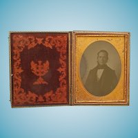 Rare 1/2 Plate Leather Case With Tinted Ruby Ambrotype of A Gentleman