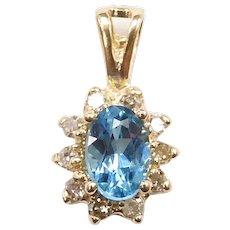 Swiss Blue Topaz and Diamond .70 ctw Halo Pendant 14k Gold