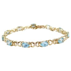 "7"" 10k Gold Blue Topaz and Diamond Hug and Kiss Bracelet"