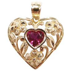 Created Ruby .60 Carat Heart Pendant with Floral Detail 10k Yellow Gold