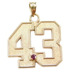 10k Gold 43 Pendant with Garnet