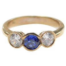 Created Sapphire and Faux Diamond 1.49 ctw Three Stone Ring 9k Gold
