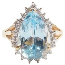 Sky Blue Topaz and Diamond 6.47 ctw Halo Ring 10k Gold Two-Tone