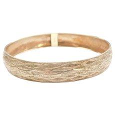 "8"" 10k Gold Textured and Diamond Cut Bangle Bracelet"