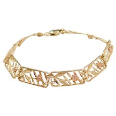 "6 1/4"" 10k Gold Two-Tone Flower Bracelet"