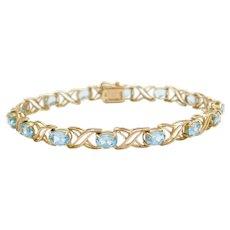"7 1/4"" 10k Gold Blue Topaz Kiss Bracelet"