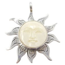 Sterling Silver Carved Resin Sun Pendant