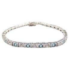 Faux Blue Topaz and Faux Diamond 5.44 ctw Tennis Bracelet Sterling Silver