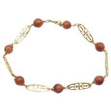"7"" 14k Gold Goldstone Bead Bracelet with Filigree Links"