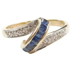 14k Gold .54 ctw Sapphire and Diamond Bypass Ring