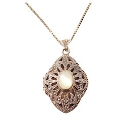 """18"""" Sterling Silver Mother of Pearl and Marcasite Perfume Locket Pendant"""