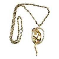 Goldtone Nude Female Figure in Rhinestone Loop Vintage Pendant Necklace