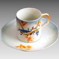 Art Deco Asian inspired motif Demitasse cup and saucer; luster ware