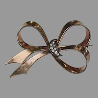 Retro bow brooch with rhinestone crescent moon, marked Mexico