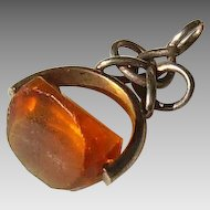 Amber glass and silver fob
