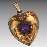 Petite heart locket with purple garnet stones