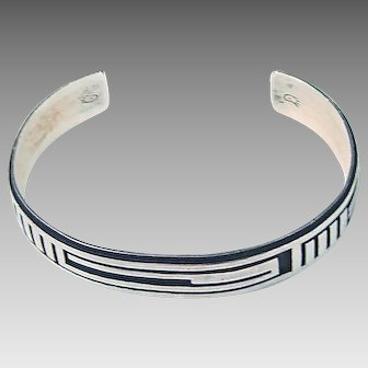Navajo or Hopi Silver incised bracelet; signed by artist