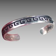Handmade Sterling Silver Cuff bracelet with incised wave or whirling dervish motif; signed