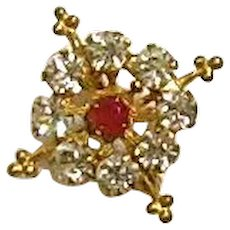 Star brooch with red and clear pastes