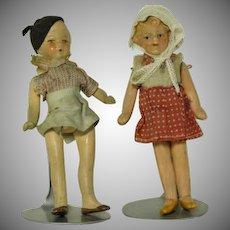"All Original  4"" composition  Boy & Girl Dolls"
