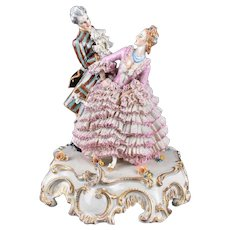 10 3/4 Antique Capodimonte Figurine with Dresden lace - Layaway