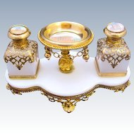 A Beautiful Palais Royal Perfume Set Comprising of 2 White Opaline Glass Scent Bottles, Each with Miniatures of Paris and Dore Bronze Mounts.