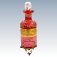 Antique MOSER Bohemian Cranberry Glass Enamelled Perfume Bottle on 3 Dore Bronze Scroll Feet.