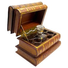 Wonderful Antique French Tantalus made from Genuine Leather Stacked Books.