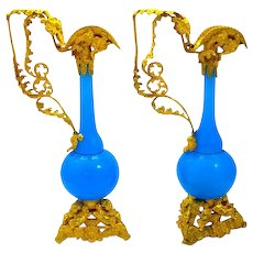 A Large Pair of Extremely High Quality Dore Bronze and Blue Opaline Glass Ewers