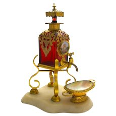This is a Wonderful and Rare Antique Ruby Red Glass and Dore Bronze Mounted Perfume Bottle Dispenser.