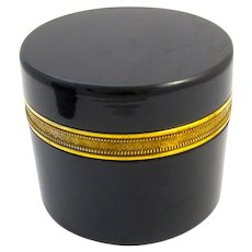 Antique Black Opaline Glass Round Casket Box and Lid and Fancy Dore Bronze Mounts .
