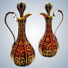 A Pair of Tall High Quality Bohemian Ruby Red Crystal Jugs with Fine Gold Enamelling.
