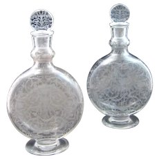 A Tall Pair of Antique Signed Baccarat Engraved Perfume Bottles and Stoppers.
