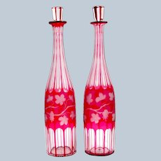 Pair of Large Antique Bohemian Pink Decanters Engraved Throughout with Fruiting Vine Leaves.