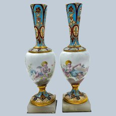 A Pair of Antique French Champlevé Candlesticks  with Cherubs.
