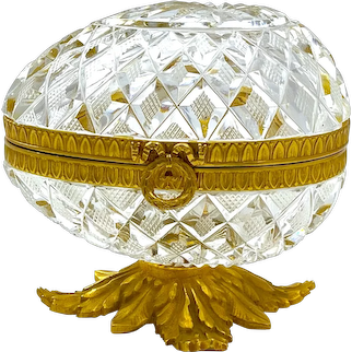 Antique Baccarat Diamond Cut Crystal Egg Shaped Casket with Dore Bronze Mounts and Bow Clasp.