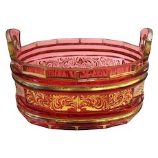 A Bohemian 19th Century cranberry glass dish decorated with gold enamelling.