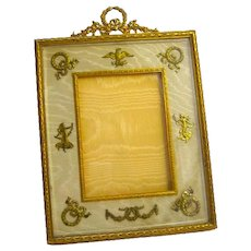 Antique Empire Dore Bronze and Silk Frame with Fine Classical Motifs.