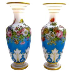 A Pair of Baccarat Opaline Glass Baluster-Shaped Vases Decorated with Polychromatic Flowers .
