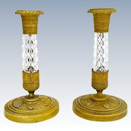 A Pair of Antique French Cut Crystal and Dore Bronze Candlesticks.