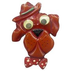 Carved Googly Eyed Bakelite Dog Pin