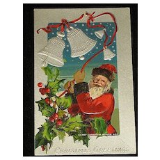 """Antique Embossed Postcard-Santa Ringing Silver Bells Tied with Red Ribbon with Holly/Berries-""""Merry Christmas Series 403""""-Unused"""