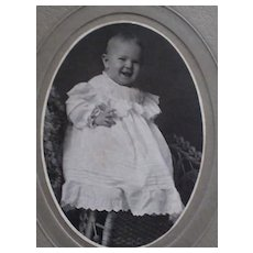 Victorian Cabinet Card with Smiling Baby Girl on Wicker Chair