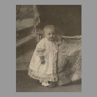 Victorian Cabinet Card with Baby Girl Standing Next to Fur Throw